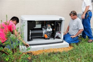 generator being installed by two technicians
