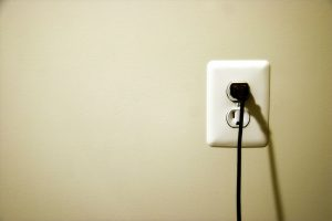 electrical outlet with plug in it