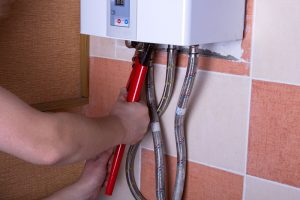 tankless water heater being repaired