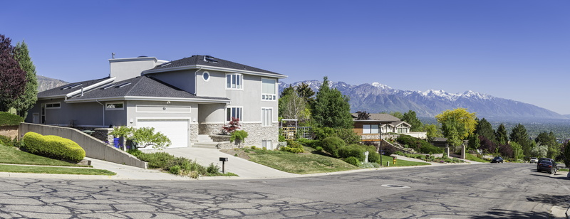 beautiful home with mountain view in background