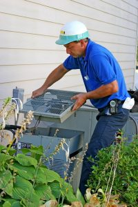 ac-technician-working-on-air-conditioner