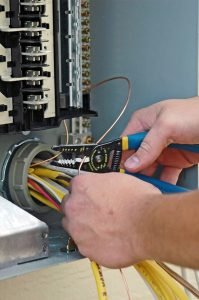 technicians-hands-working-on-electrical-panel