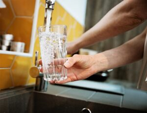 hand-holding-glass-of-water