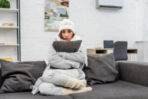 woman-hugging-pillow-looking-cold