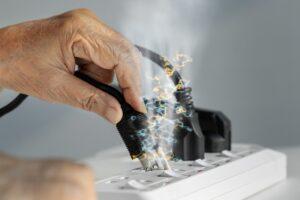 hand-holding-sparking-plug