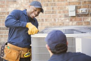 two-technicians-working-on-outdoor-ac-unit